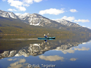 Winter kayaking on Slocan Lake. by Rick Tegeler