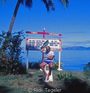 What time is it?  On the international date line on Taveu... by Rick Tegeler