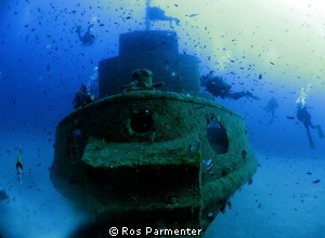 Divers approaching the wreck of the Rozi by Ros Parmenter