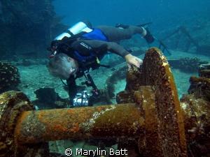 Diver videoing wreck by Marylin Batt