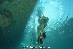 Italian Navy Hard hat diver, ascendig to the surface afte... by Antonio Colacino