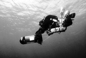 Tech Diver on his way to the deep.... by Andreas Kutsch