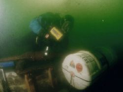A diver investigates why this liferaft didn't deploy when... by Michael Grebler