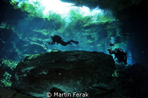 Divers in cenote by Martin Ferak