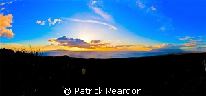 Sunset panorama taken from the side of Haleakala, Maui. by Patrick Reardon