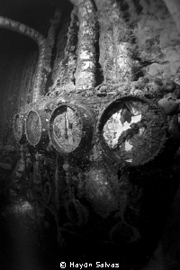 Inside the engine room of the Heian Maru in Truk, lots of... by Haydn Salvas