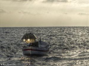 "Mediterranean ""Lampara"" at sunset. This old fishing stra... by Marco Faimali"