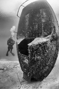 vertical standing boat wreck and diver, Wraysbury, Middle... by Nick Blake