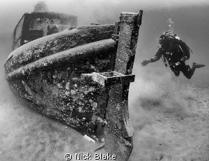 Small Boat wreck and diver, Wraysbury Lake by Nick Blake