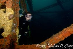 A Diver exploring one of the bridge spans down in Panama ... by Michael Shope