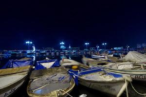 Fishing boats during night. Bulb shot ( 30 sec. exposure ... by Rico Besserdich