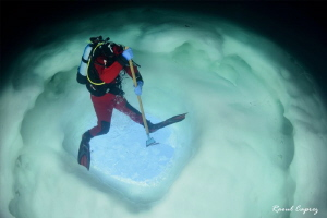 Another way to dig a hole in the ice :-) (upside down pi... by Raoul Caprez