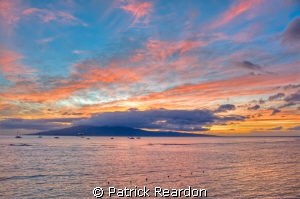 Sunset over Lanai as seen from Lahaina, Maui. by Patrick Reardon