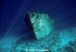 Wreck on Kuredu house reef by Peet Van Eeden