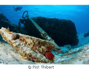 diver and anchor by Rick Thibert