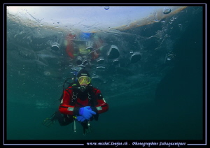 Diving under the ice... :O)... by Michel Lonfat