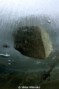 Stone in the ice... by Viktor Vrbovský