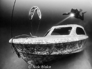 Diver and small boat wreck, Wraysbury Black and white co... by Nick Blake