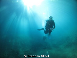 Parting the Rays - Blue Hole Santo Vanuatu. Taken with Ca... by Brendan Steel