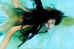 Aisha. Shot in pool. Nikon D300, Sea & Sea housing, 110a... by Alec Davies