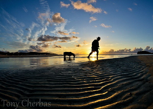 Sunset at Jimmy Dee's, Guam by Tony Cherbas