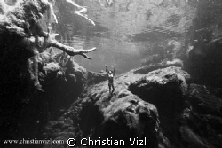 Woman Free Diving at Cenote Jardin del Eden, Quintana Roo... by Christian Vizl