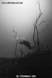 Cavern Diver entering a sulfur layer at 120 feet inside C... by Christian Vizl