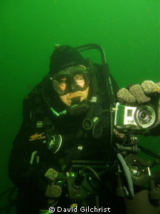 Diver adjusts Go Pro camera mounted on top of the Shark M... by David Gilchrist