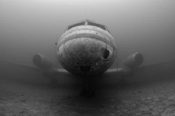 Here is a  plane wreck here in the UK. It sits in 20 metr... by Spencer Burrows