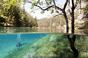 Another half & half shot from the 'green lake' in Austria by Marco Walter