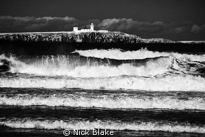 View to Inner Farnes from the shoreline, Seahouses. Fuji... by Nick Blake