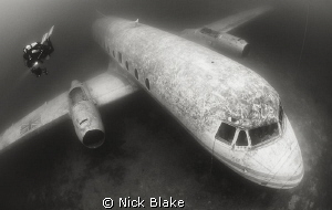 Diver and plane wreck, Capernwray. by Nick Blake