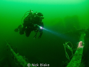 Diver exploring the wreck of the Somali, Northumberland by Nick Blake