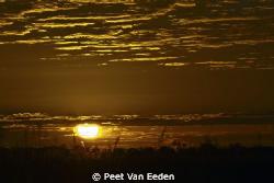 sunrise over the Okavango swamps, Moremi, Botswana. One o... by Peet Van Eeden