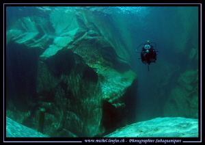 My wife diving the Verzasca river... Que du bonheur.. :O)... by Michel Lonfat