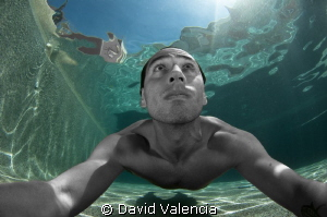 a self-portrait in the pool. by David Valencia