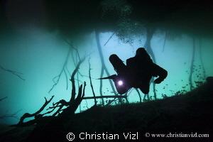 Cave diver at cenote Aktun Ha, Quintana Roo, Mexico by Christian Vizl
