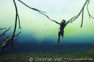 Selkie woman at cenote Carwash, Quintana Roo, México. by Christian Vizl