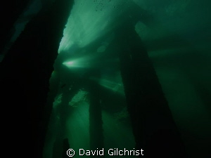 Silhouette, beneath the Piers at the Swing Bridge site, W... by David Gilchrist