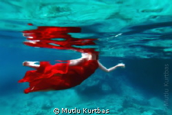 She is swimming in the sea with red dress and fresh water... by Mutlu Kurtbas