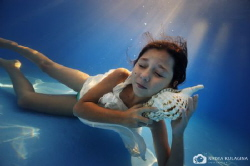 The sound of the ocean...  Modeling for the first time,... by Nadya Kulagina