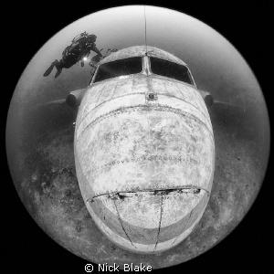 Jet Plane and diver, Capernwray. Sigma circular fish eye... by Nick Blake