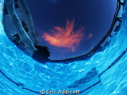Sunset from the bottom of the pool...just one cloud up th... by Eric Addicott
