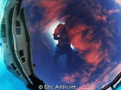 Bottom of pool sunset with surface reflection of photogra... by Eric Addicott