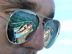 The old shiny sunglasses trick. A dive buddy on the deck ... by Jan Messersmith