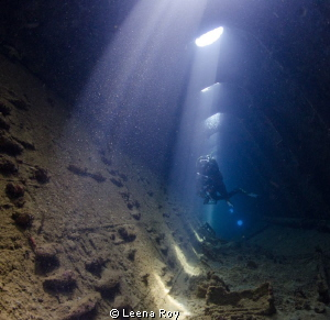 Diver in wreck of  Umbria by Leena Roy