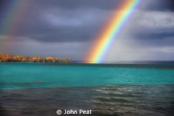 Just shot this Rainbow over Torch Lake. An inland lake in... by John Peal
