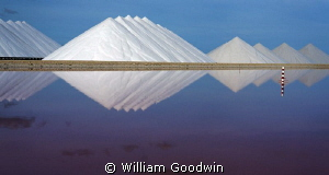 The iconic salt mounds on Bonaire during wind reversal/st... by William Goodwin