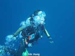 Acending after a deep dive. by Rita Hung