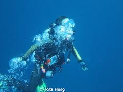 Acending after a deep dive. by Rita Hung
